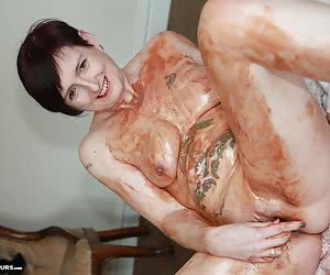 From the start you know this is going to get messy. Little pots of chocolate poured on me and then rubbed in to cover me