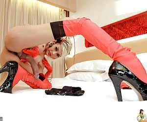 I feel like a funky spunky chick in my long red leather boots, laced up to my hot stocking clad thighs, and matching red