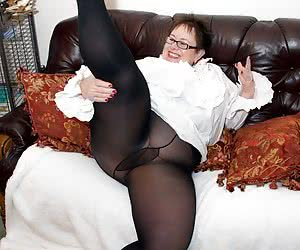 Heres a Hot Photoset of your Favourite BBW Warm Sweet Honey and shes feeling Frisky in her White Shirt and black tights