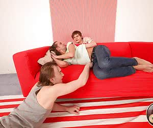 Handsome guy has his sweet ass-hole double drilled by two nasty twinks on a new sofa.