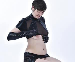 in Wetlook Outfit and with matching gloves and heels.