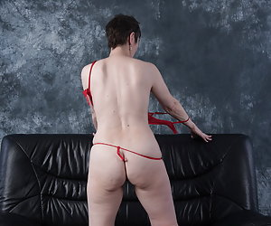On the sofa in Red Lingerie.The strip was so nice for me.Love lingerie but Nude, I prefer to be in front of the Camera.