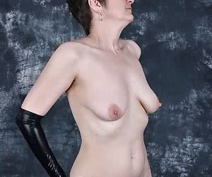 Play the Nipples Games with my nipples.First a strip.And then I play with the wetlook gloves.Pull and turn my nipples.Th