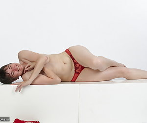 Poses on wooden boxes in lingerie.Not really comfortably but that does not prevent me horny posturing.And my hands playi