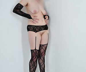 Posing in the studio in Lingerie, stockings and nylons.So quite slowly taken offAnd the photographer lies to me at feet