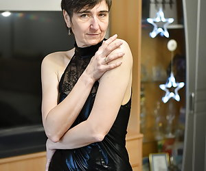 Striptease for the Advent Season in the living room.In black Wet Look dress.A Striptease of the finest.Until I'm Naked.