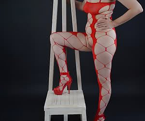 What a horny chair in the photo studio.I really in an horny catsuit on the chair.