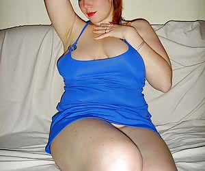 Amateur snapshot pictures of voluptuous big tits redhead Jessica showing her big tits and upskirt pussy.