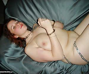 Amateur snapshot pictures of voluptuous big tits redhead Jessica stripping nude while playing with metal chains and hand