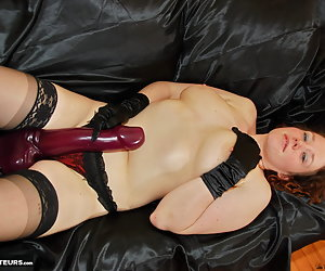 Horny redhead Jessica loves stretching her cunt with her giant vibrating dildo cock sex toy.