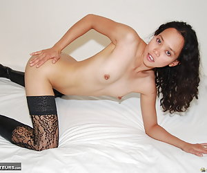 Kimberley, Filipino porn model nude and showing her horny wet cunt.