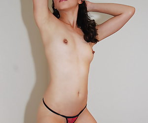 Kimberley, topless horny Filipino porn model teases before stripping down her thong.