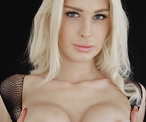 Mandy Slim is dressed in black lingerie and loves playing with her pink vibrator.