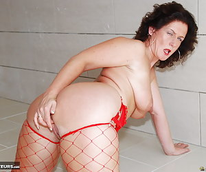 Manuela, horny mature milf slut is stripping nude. Manuela is showing spread legs and fingering her pussy.