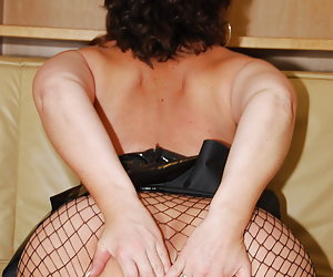 Manuela, horny slut whore is stripping off her latex mini-skirt and is showing her big mature milf ass. Manuela loves ma