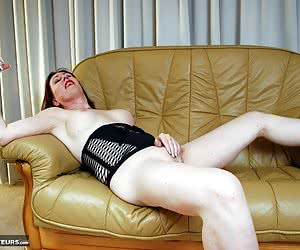 Model Ammomi is wearing a sexy short black dress and high heels.Ammomi enjoys touching herself all over and showing her