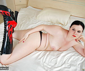 Mona Summers, horny young Dutch pornstar dressed in black lingerie and boots is showing her pussy and stripping topless