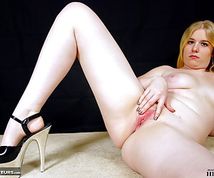 Mona Summers, teasing and stripping off her jeans and white corset.When Mona is all nude and only wearing her high heels