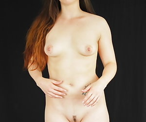 Zo Davis is having a good time with her vibrator inside her pussy.