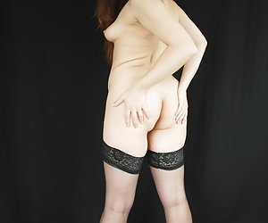Zoe Davis is stripping nude and showing her nice ass.