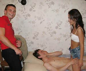 An amateur MMF threesome in the living room images