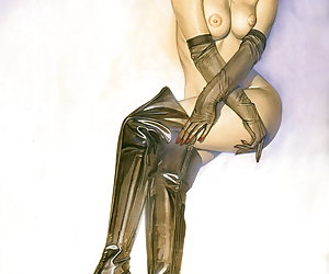 Divine blonde angel in black corset and high black boots