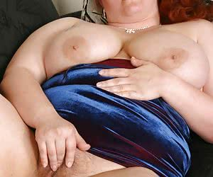 Plump redhead babe caresses her fat pussy lips