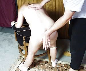 Chubby girl adhered to the chair and spanked
