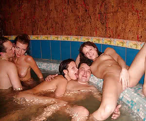 Horny couples fucking and changing partners in the pool