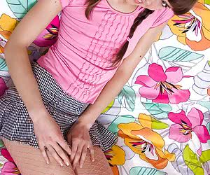 Beautiful eighteen years old girlie in a short skirt and net pantyhose gets nasty