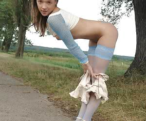 Gorgeous teen beauty getting out of her clothes right on the road