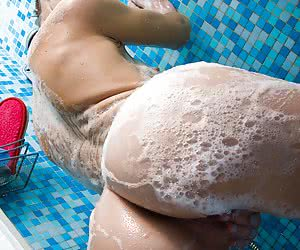 Skinny barely legal model relaxing and luxuriating under a warm shower