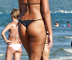 Hot looking chicks in sexy thongs caught on film by amateurs
