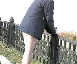 It was getting cold and this chick had her pantyhose on when I got a few rear view upskirts of her