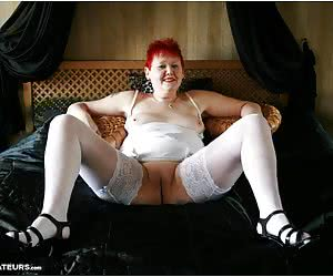 White looks great on black and I hope that you think I look hot in this lingerie.