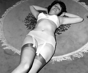 Being not able to ignore the desire, hothead chick starts posing in her white retro lingerie