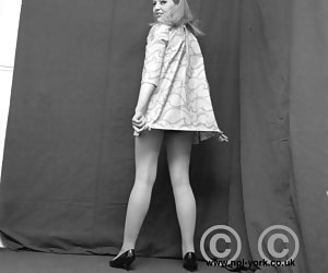 Playful chicks pose in short dresses and proudly demonstrate their vintage lingerie in heat