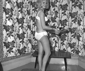 Sexy blonde poses in white vintage lingerie and lets you take a glance at her slim body