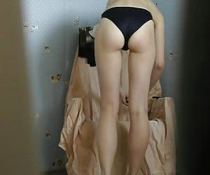 Cute girl dressed only in panties fixed by home voyeur cam while she makes up herself