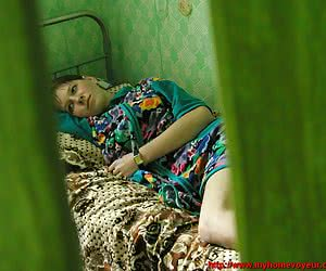 Girlie relaxing in her maiden bed and then undressing was caught by private voyeur cam